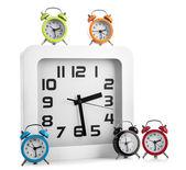 White wall clock and several alarm clock — Stock Photo
