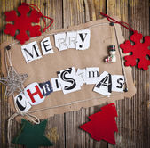 Merry Christmas - made from newspaper letters — Stock Photo