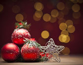 Christmas decoration with red bauble — Stock Photo