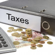 Taxes Binder Calculator and Currency — Stock Photo
