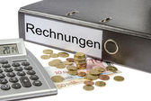 Rechnungen Binder Calculator and Currency — Stock Photo