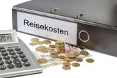 Reisekosten Binder Calculator and Currency — Stock Photo