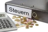 Steuern Binder Calculator and Currency — Stock Photo