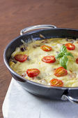 Omelette in pan — Stock Photo
