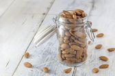 Almonds in a jar — Stock Photo
