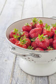 Strawberries in a sieve — Stock Photo