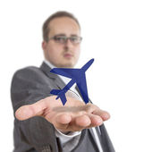 Business man holding aircraft Symbol — Stock Photo