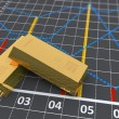 Two gold bars with a linear graph — Stock Photo #25756683