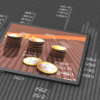 Tablet with bar chart and coins — Stock Photo #25756855