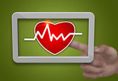 Cardiogram tablet — Stock Photo
