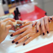 Professional nail polish applying — Stock Photo