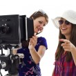 Two girls making photos - Stock Photo