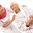Medical care for an old woman - Stock Photo