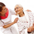 Medical care for an old woman — Stock Photo #22804276