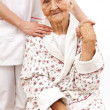 Young doctor's helping hand for the elder ones — Stock Photo #22804304
