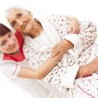 Medical care for an old woman — Stock Photo #22804324