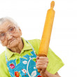 Old woman with a rolling pin — Stock Photo #22804354