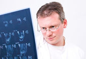 Doctor with a magnetic resonance image — Stock Photo