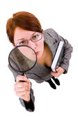 Woman with magnifier — Stock Photo