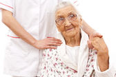 Young doctor's helping hand for the elder ones — Stock Photo