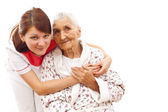 Medical care for an old woman — Stock Photo