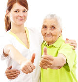 Doctor and patient showing thumbs up — Stock Photo