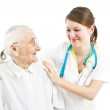 Doctor taking care of an old lady — Stock Photo #23467526