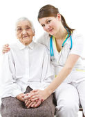 Doctor taking care of an old lady — Stock Photo