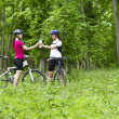 Girls biking in the forest — Stock Photo #27361439