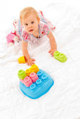 Little girl playing with building blocks — Stock Photo