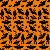 Seamless pattern with bats — Stock Vector