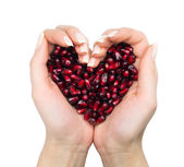 Female woman hands, pomegranate, talets — Stock Photo