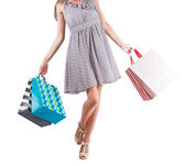 Young woman with shopping bags isolated white background — Stock Photo