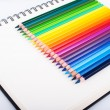 Colored pencils on a notebook — Stock Photo