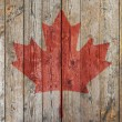 Canadian flag wooden background — Stock Photo