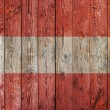 Austrian flag on old wooden background — Stock Photo