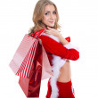 Happy smiling woman in santa claus clothes with present box. — Stock Photo #35278879