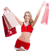 Happy smiling woman in santa claus clothes with present box. — Stock Photo