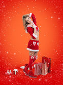 Happy smiling woman in santa claus clothes — Stock Photo