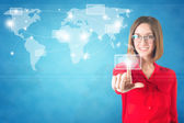 Business woman finger touching world map on a touch screen — Stock Photo