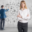 Portrait of young businesswoman director boss professional consultant manager and businessman drawing  business plan, graph, chart on wall — Stock Photo #48139247