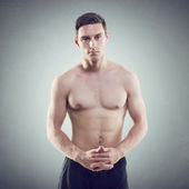 Portrait of an attractive athlete sportsman muscular handsome sexy guy in sport dress, strong man, naked  torso — Stock Photo