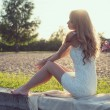 Sunny outdoors portrait of a beautiful young romantic woman or girl under sunset. Summer evening nature. Soft light. Toned warm colors. — Stock Photo #48769443