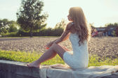 Sunny outdoors portrait of a beautiful young romantic woman or girl under sunset. Summer evening nature. Soft light. Toned warm colors. — Stock Photo