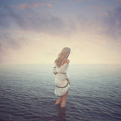Beautiful girl in the water. Beach, sunset, evening. concept love romance — Stok fotoğraf