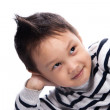 Stock Photo: Little boy clouse up
