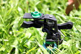 Focus The Sprinkler on Grass. — Stock Photo