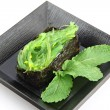 Green Seaweed Sushi on the dish. — Stock Photo