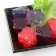 Red jelly and purple jelly in dish. — Stock Photo #26300359