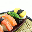 Seafoods Sushi on Black bamboo dish. — Stock Photo #26308577